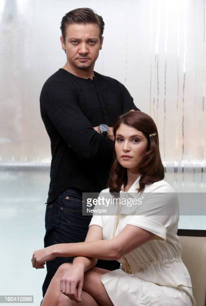 Actors Jeremy Renner and Gemma Arterton pose during a photo shoot to promote their new film 'Hansel and Gretel Witch Hunters' on January 29 2013 in...