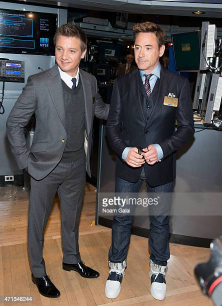 Actors Jeremy Renner and Robert Downey Jr visit the New York Stock Exchange on April 27 2015 in New York City