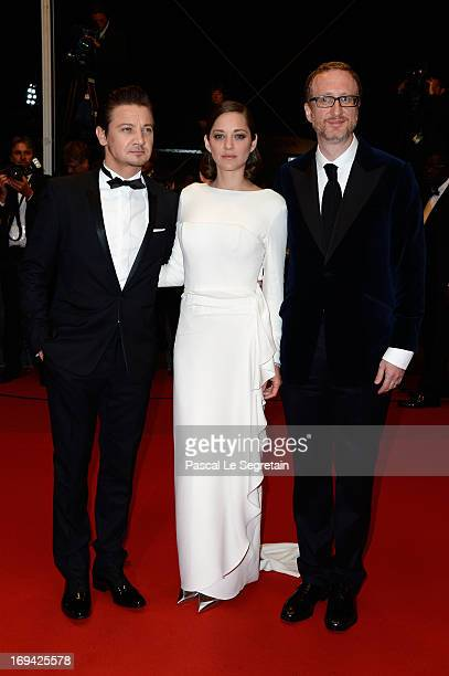 Actors Jeremy Renner Marion Cotillard and director James Gray leave 'The Immigrant' Premiere during the 66th Annual Cannes Film Festival at Grand...