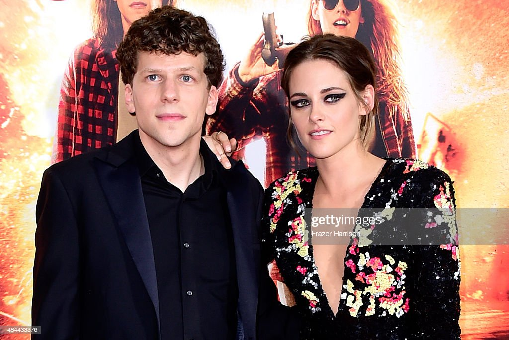 Actors Jesse Eisenberg (L) and Kristen Stewart attend PalmStar Media And Lionsgate's 'American Ultra' premiere at the Ace Theater Downtown LA on August 18, 2015 in Los Angeles, California.