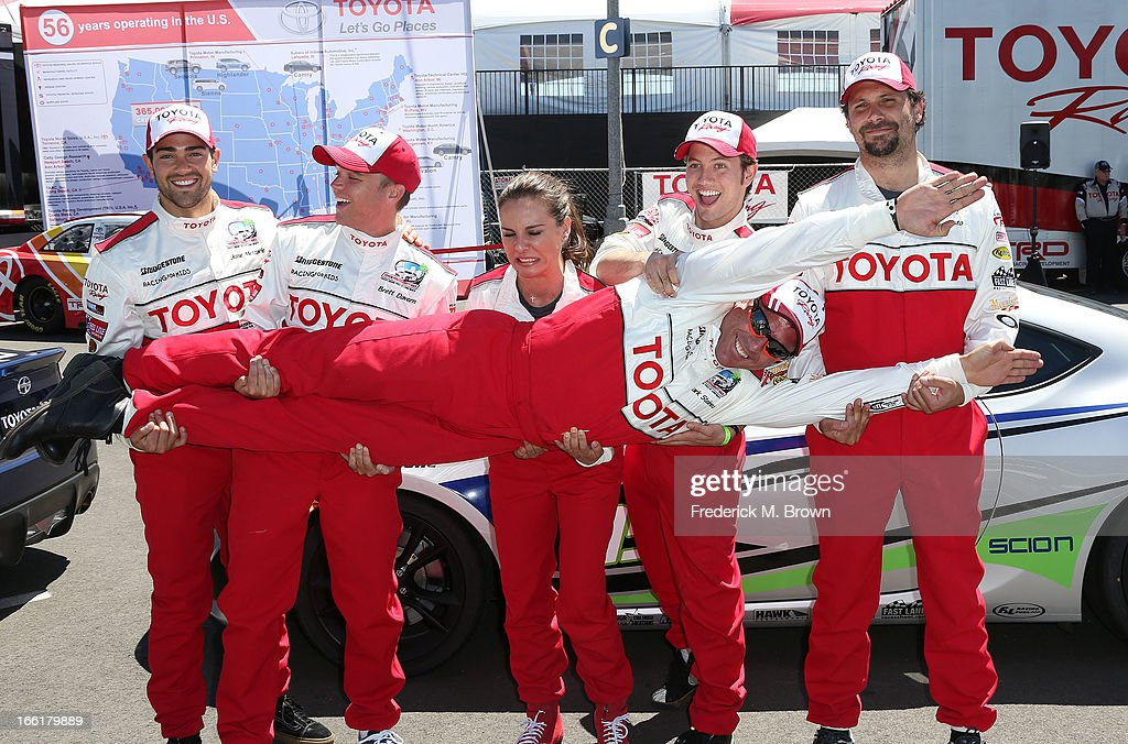 Actors Jesse Metcalfe, and Brett Davern, and actress Kate del Castillo, and actors Jackson Rathbone, and Jeremy Sisto lift television host Mark Steines during the 37th Annual Toyota Pro/Celebrity Race-Practice Day on April 9, 2013 in Long Beach, California.