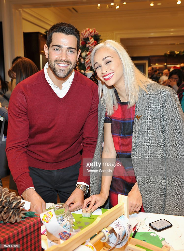 Actors Jesse Metcalfe (L) and Cara Santana attend the Brooks Brothers holiday party with St Jude Children's Research Hospital at Brooks Brothers on Rodeo Drive on December 5, 2015 in Beverly Hills, California.