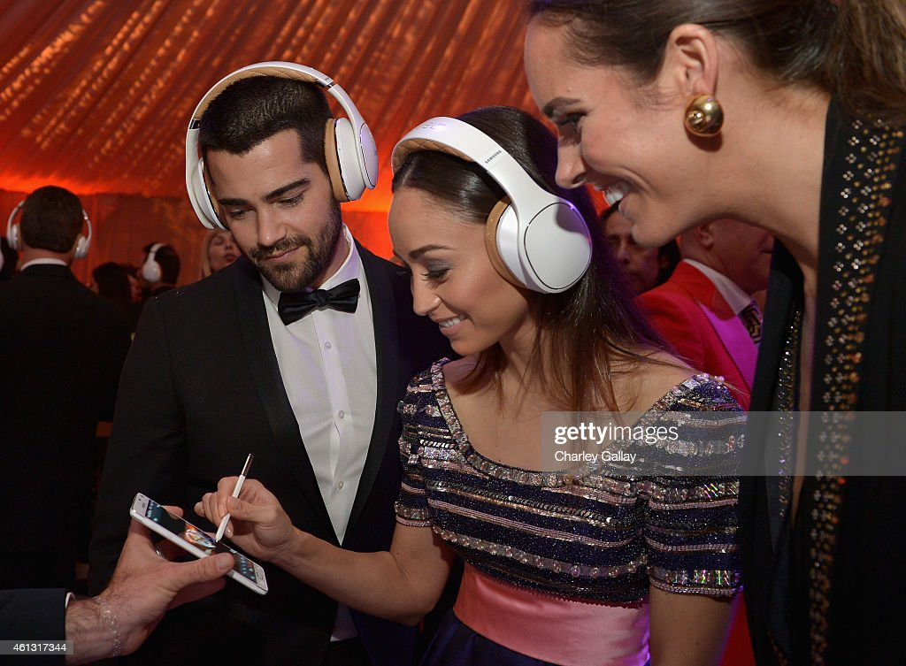 Actors Jesse Metcalfe and Cara Santana both wearing Samsung Level headphones attend the 8th Annual HEAVEN Gala presented by Art of Elysium and...