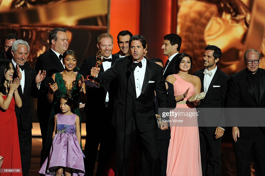 Actors Jesse Tyler Fergueson, Sofia Vergara, Ty Burrell, writer Steven Levitan, and Ariel Winter speak onstage during the 65th Annual Primetime Emmy Awards held at Nokia Theatre L.A. Live on September 22, 2013 in Los Angeles, California.