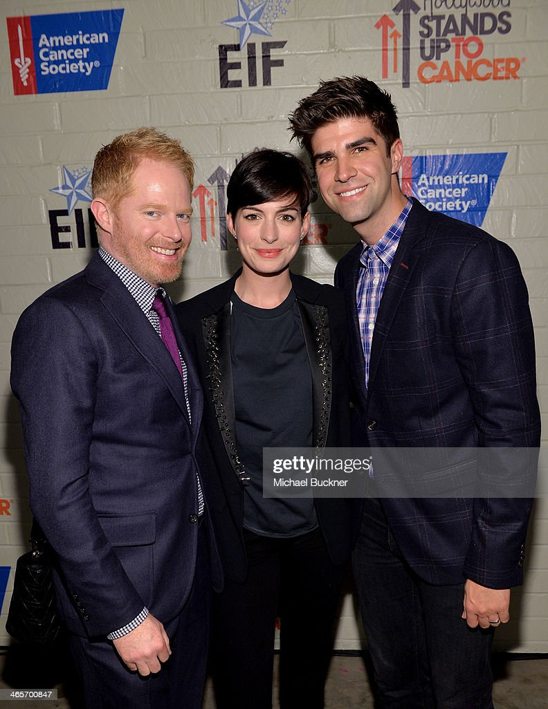 Actors Jesse Tyler Ferguson and Anne Hathaway and Justin Mikita attend Hollywood Stands Up To Cancer Event with contributors American Cancer Society and Bristol Myers Squibb hosted by Jim Toth and Reese Witherspoon and the Entertainment Industry Foundation on Tuesday, January 28, 2014 in Culver City, California.