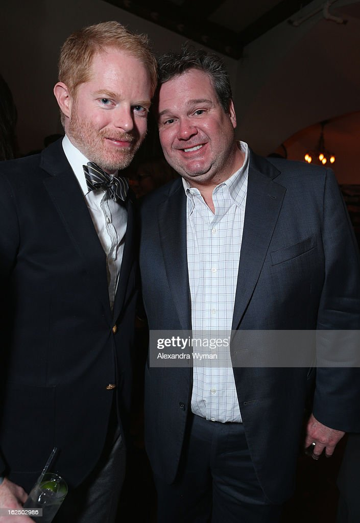 Actors Jesse Tyler Ferguson (L) and Eric Stonestreet attend GREY GOOSE Pre-Oscar Party hosted by Michael Sugar, Doug Wald, Nathan Kahane and Warren Zavala at Chateau Marmont on February 23, 2013 in Los Angeles, California.