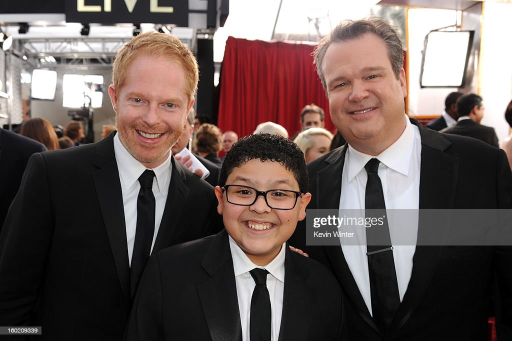 Actors Jesse Tyler Ferguson, Rico Rodriguez and Eric Stonestreet attend the 19th Annual Screen Actors Guild Awards at The Shrine Auditorium on January 27, 2013 in Los Angeles, California. (Photo by Kevin Winter/WireImage) 23116_017_0695.JPG