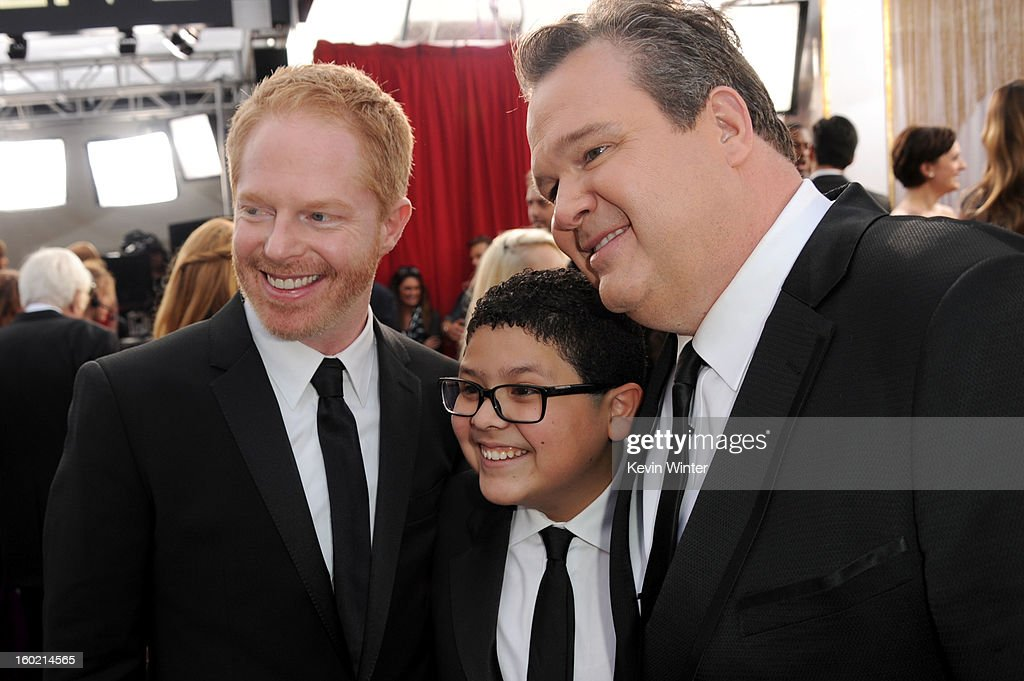 Actors Jesse Tyler Ferguson (L), Rico Rodriguez (C) and Eric Stonestreet (R) attend the 19th Annual Screen Actors Guild Awards at The Shrine Auditorium on January 27, 2013 in Los Angeles, California. (Photo by Kevin Winter/WireImage) 23116_017_0684.JPG