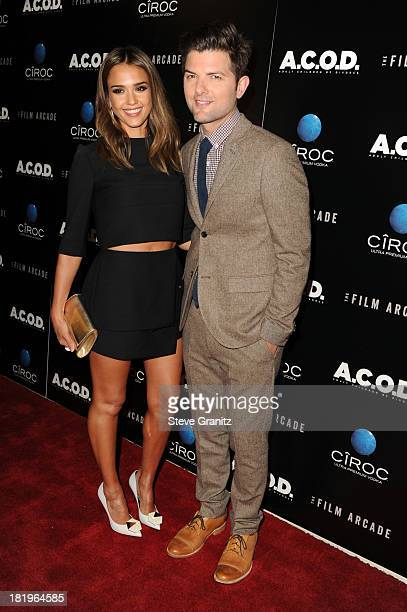 Actors Jessica Alba and Adam Scott arrive at the 'ACOD' premiere at the Landmark Theater on September 26 2013 in Los Angeles California