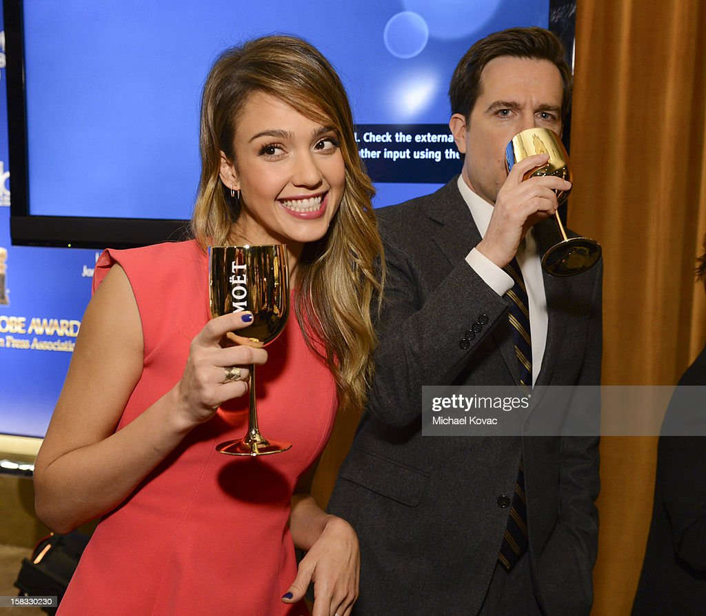 Actors Jessica Alba and Ed Helms toast the 70th Annual Golden Globe Nominations with Moet & Chandon at the The Beverly Hilton on December 13, 2012 in Los Angeles, California.