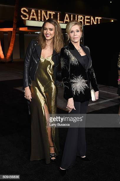 Actors Jessica Alba and Jane Fonda in Saint Laurent by Hedi Slimane attend Saint Laurent at the Palladium on February 10 2016 in Los Angeles...