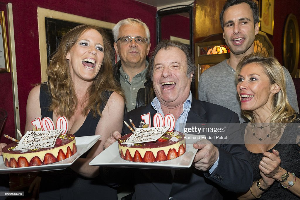Actors Jessica Borio, Daniel Russo and Axelle Marine, foreground, director Eric Civanyan and playwright and actor Jean-Francois Cros, background, pose with cakes celebrating the 100th performance of the play 'Hier Est Un Autre Jour' at Theatre des Bouffes Parisiens on May 11, 2013 in Paris, France.