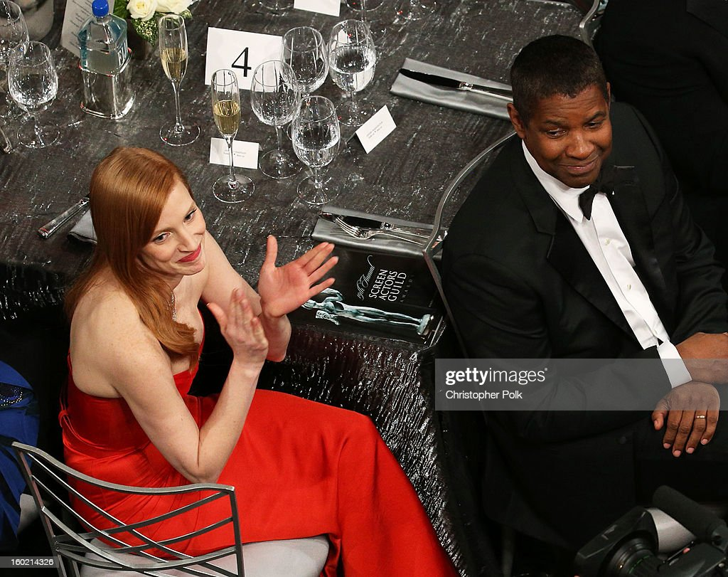Actors Jessica Chastain (L) and Denzel Washington attend the 19th Annual Screen Actors Guild Awards at The Shrine Auditorium on January 27, 2013 in Los Angeles, California. (Photo by Christopher Polk/WireImage) 23116_012_1336.jpg