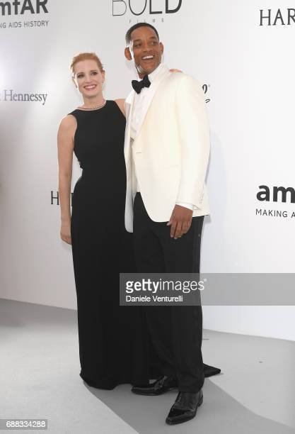 Actors Jessica Chastain Will Smith arrive at the amfAR Gala Cannes 2017 at Hotel du CapEdenRoc on May 25 2017 in Cap d'Antibes France