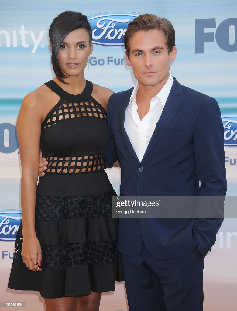 Actors Jessica Lucas and Kevin Zegers arrive at the 2014 FOX Fall EcoCasino Party at The Bungalow on September 8 2014 in Santa Monica California