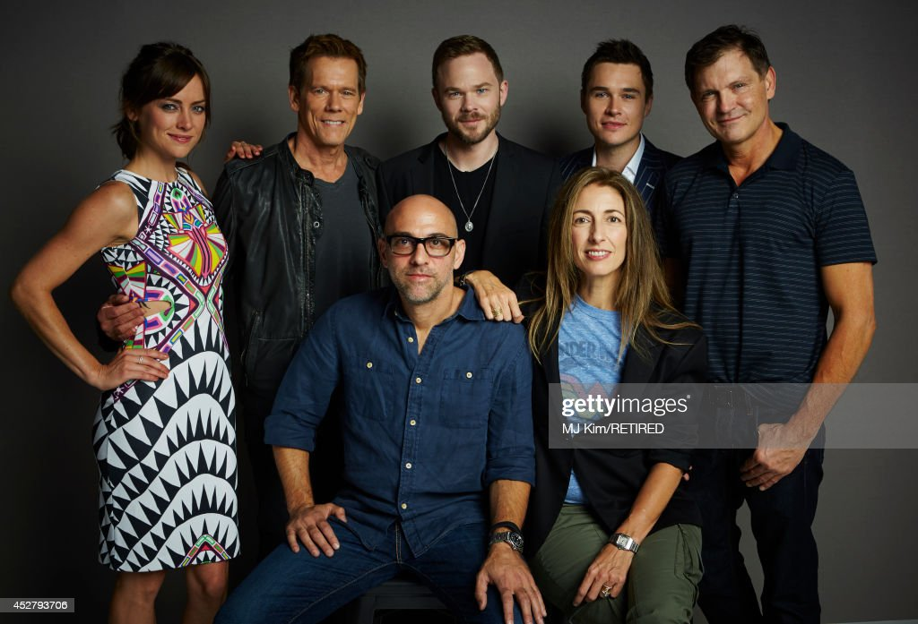 Actors Jessica Stroup, Kevin Bacon, Shawn Ashmore, Sam Underwood, producer Kevin Williamson, (Front Row L-R) director Marcos Siega, and producer Jennifer Johnson pose for a portrait at the Getty Images Portrait Studio Powered By Samsung Galaxy at Comic-Con International 2014 at Hard Rock Hotel San Diego on July 27, 2014 in San Diego, California.