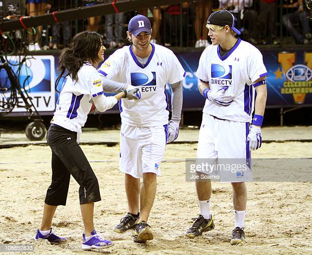 Actors Jessica Szohr Chase Crawford and Chord Overstreet compete in DIRECTV's Fifth Annual Celebrity Beach Bowl at Victory Park on February 5 2011 in...