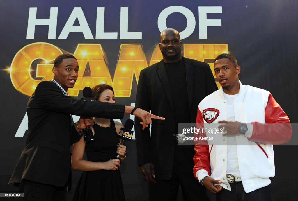 Actors Jessie Usher and Aimee Carrero, host <a gi-track='captionPersonalityLinkClicked' href=/galleries/search?phrase=Shaquille+O%27Neal&family=editorial&specificpeople=201463 ng-click='$event.stopPropagation()'>Shaquille O'Neal</a> and co-host <a gi-track='captionPersonalityLinkClicked' href=/galleries/search?phrase=Nick+Cannon&family=editorial&specificpeople=202208 ng-click='$event.stopPropagation()'>Nick Cannon</a> attend the Third Annual Hall of Game Awards hosted by Cartoon Network at Barker Hangar on February 9, 2013 in Santa Monica, California. 23270_002_SK_1141.JPG