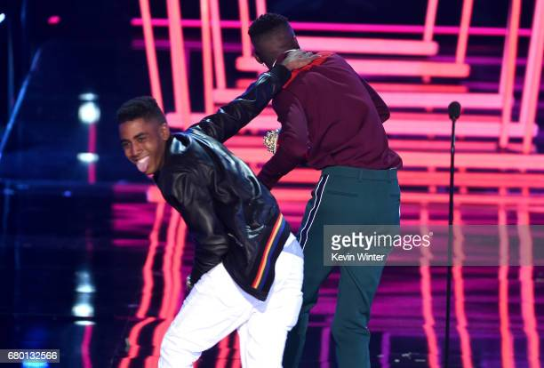 Actors Jharrel Jerome and Ashton Sanders accept Best Kiss for 'Moonlight' onstage during the 2017 MTV Movie And TV Awards at The Shrine Auditorium on...