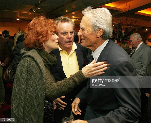 Actors Jill St John her husband Robert Wagner and actor/director Clint Eastwood talk at the afterparty for the premiere of Paramount's 'Flags Of Our...