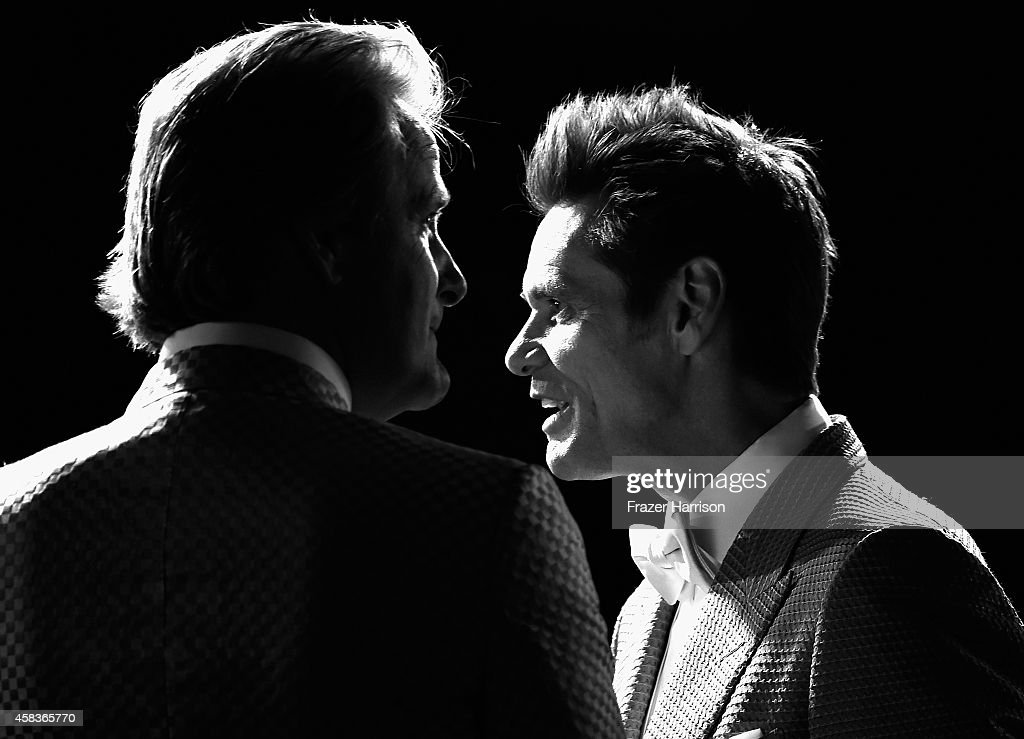. Actors Jim Carrey (RL) and Jeff Daniels arrive at the premiere of Universal Pictures and Red Granite Pictures' 'Dumb And Dumber To' on November 3, 2014 in Westwood, California.