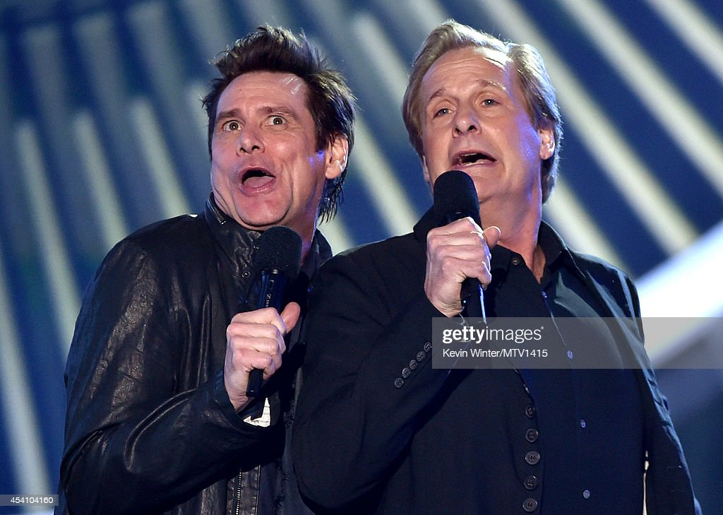 Actors Jim Carrey (L) and Jeff Daniels speak onstage during the 2014 MTV Video Music Awards at The Forum on August 24, 2014 in Inglewood, California.