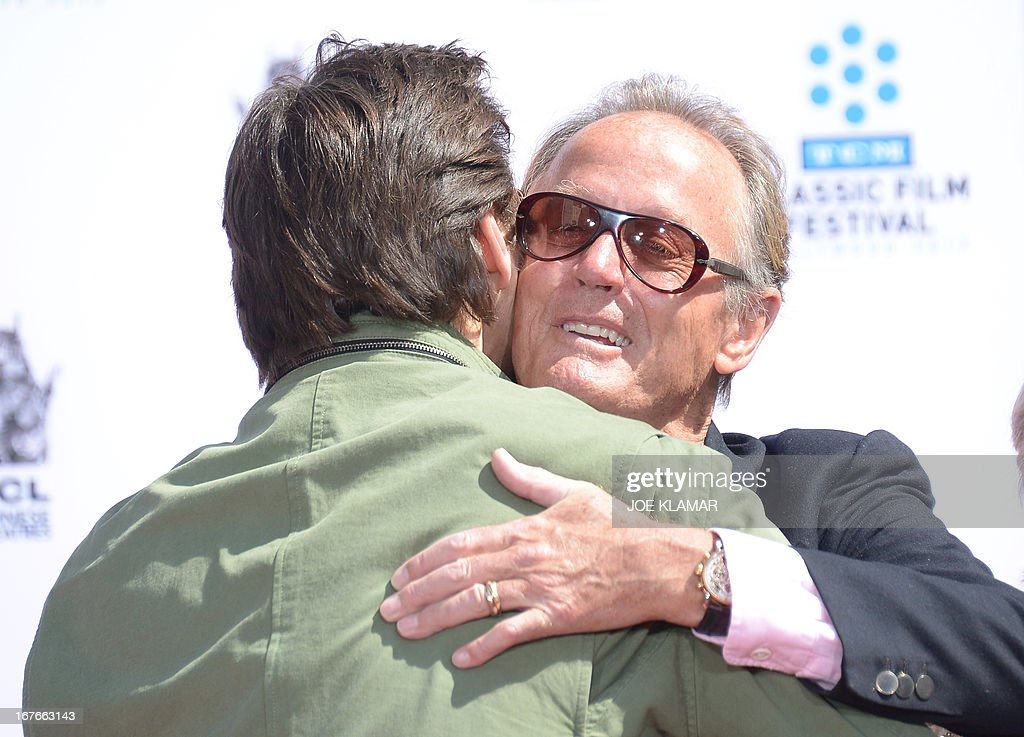 Actors Jim Carrey (L) and Peter Fonda attend actress Jane Fonda's Handprint/Footprint Ceremony during the 2013 TCM Classic Film Festival at TCL Chinese Theatre on April 27, 2013 in Los Angeles. Fonda is an American actress, writer, political activist, former fashion model, and fitness guru. She rose to fame in the 1960s with films such as Barbarella and Cat Ballou. She has won two Academy Awards, an Emmy Award, three Golden Globes and received several other movie awards and nominations during more than 50 years as an actress. After 15 years of retirement, she returned to film in 2005 with Monster-in-Law, followed by Georgia Rule two years later. She also produced and starred in over 20 exercise videos released between 1982 and 1995, and once again in 2010.