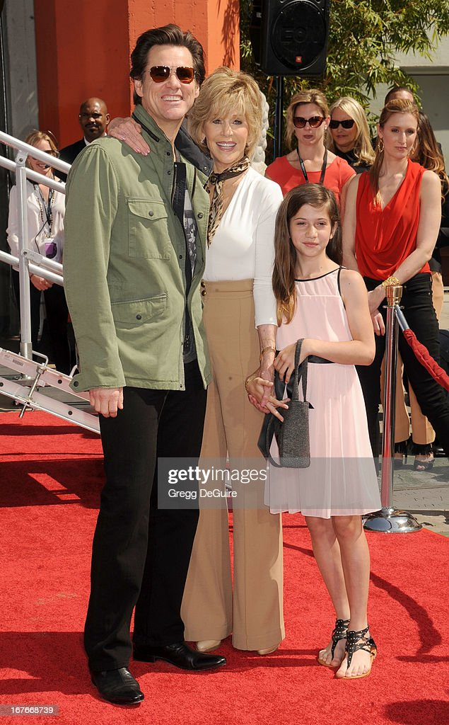 Actors Jim Carrey, Jane Fonda and granddaughter Viva Vadim pose at Jane Fonda's hand and footprints ceremony at TCL Chinese Theatre on April 27, 2013 in Hollywood, California.