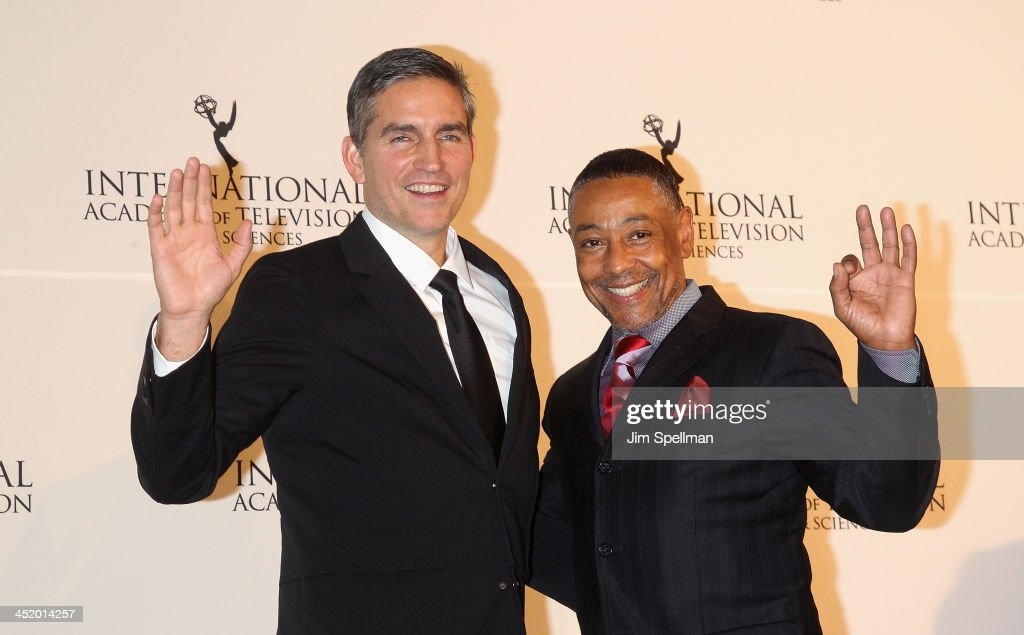 Actors Jim Caviezel and <a gi-track='captionPersonalityLinkClicked' href=/galleries/search?phrase=Giancarlo+Esposito&family=editorial&specificpeople=725984 ng-click='$event.stopPropagation()'>Giancarlo Esposito</a> attend the 41st International Emmy Awards at the Hilton New York on November 25, 2013 in New York City.