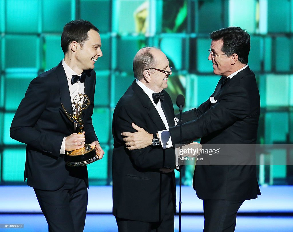 Actors Jim Parsons and Bob Newhart present an award to Stephen Colbert onstage during the 65th Annual Primetime Emmy Awards held at Nokia Theatre LA...