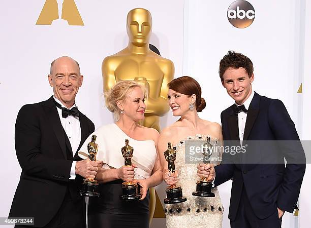 Actors JK Simmons Patricia Arquette Julianne Moore and Eddie Redmayne pose in the press room during the 87th Annual Academy Awards at Loews Hollywood...
