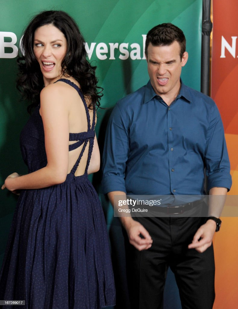 Actors Joanne Kelly and Eddie McClintock arrive at the 2013 NBC Summer Press Day at The Langham Huntington Hotel and Spa on April 22, 2013 in Pasadena, California.