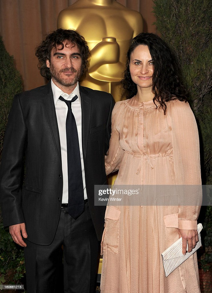 Actors Joaquin Phoenix (L) and Rain Phoenix attend the 85th Academy Awards Nominees Luncheon at The Beverly Hilton Hotel on February 4, 2013 in Beverly Hills, California.