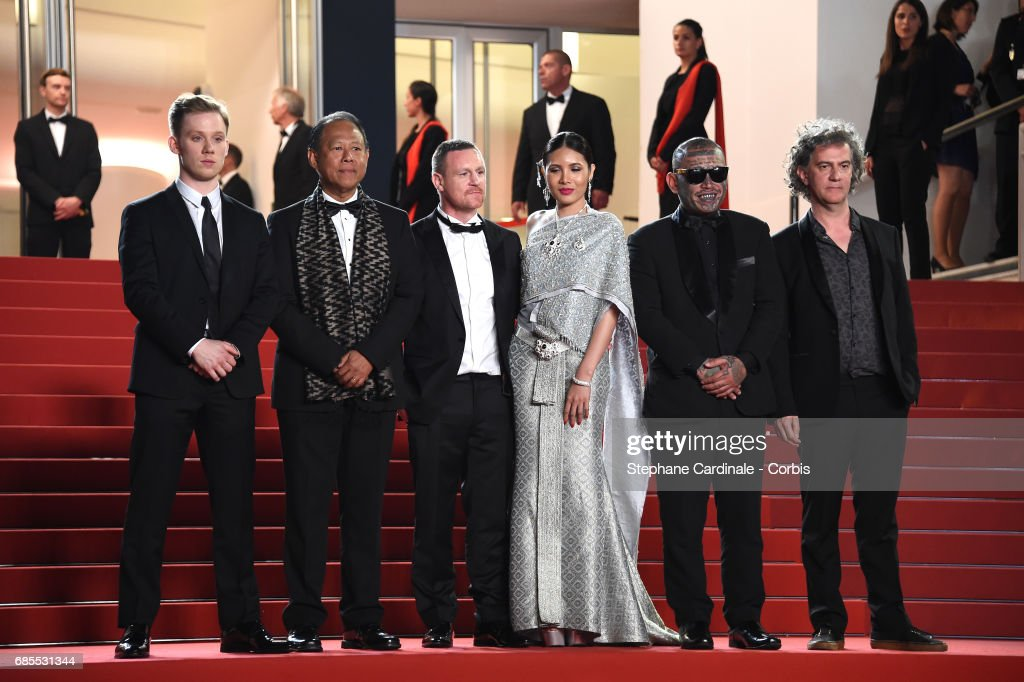 Actors Joe Cole and Vithaya Pansringarm, former boxer Billy Moore, actors Pornchanok Mabklang and Panya Yimumphai and director Jean-Stéphane Sauvaire attend the 'A Prayer Before Dawn' screening during the 70th annual Cannes Film Festival at Palais des Festivals on May 19, 2017 in Cannes, France.