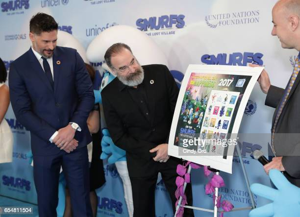 Actors Joe Manganiello and Mandy Patinkin view the Smurf stamp designs that will be available at the UN Post office as they are presented by UN OCSS...