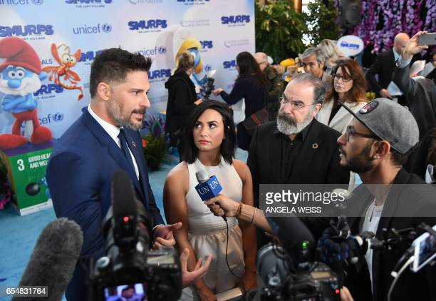 Actors Joe Manganiello Demi Lovato and Mandy Patinkin speak with journalists at the International Day of Happiness in conjunction with SMURFS THE...