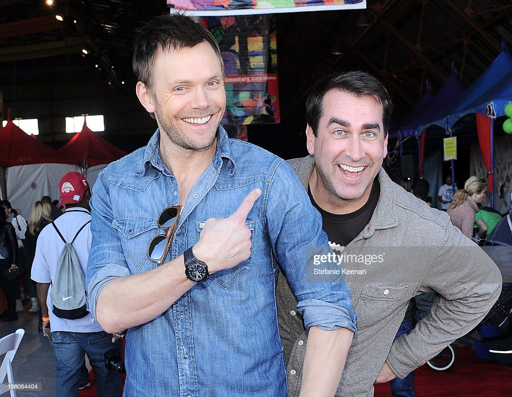 Actors <a gi-track='captionPersonalityLinkClicked' href=/galleries/search?phrase=Joel+McHale&family=editorial&specificpeople=754384 ng-click='$event.stopPropagation()'>Joel McHale</a> and <a gi-track='captionPersonalityLinkClicked' href=/galleries/search?phrase=Rob+Riggle&family=editorial&specificpeople=2789494 ng-click='$event.stopPropagation()'>Rob Riggle</a> attend the creative arts fair and family day 'Express Yourself', supporting P.S. ARTS, at Barker Hangar on November 11, 2012 in Santa Monica, California.