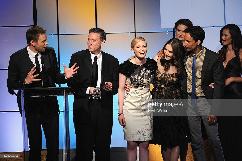 Actors Joel McHale, producer Russ Krasnoff, <a gi-track='captionPersonalityLinkClicked' href=/galleries/search?phrase=Gillian+Jacobs&family=editorial&specificpeople=4836757 ng-click='$event.stopPropagation()'>Gillian Jacobs</a>, <a gi-track='captionPersonalityLinkClicked' href=/galleries/search?phrase=Alison+Brie&family=editorial&specificpeople=5447578 ng-click='$event.stopPropagation()'>Alison Brie</a> and <a gi-track='captionPersonalityLinkClicked' href=/galleries/search?phrase=Danny+Pudi&family=editorial&specificpeople=6106772 ng-click='$event.stopPropagation()'>Danny Pudi</a> of Community accept the award for 'Best Comedy Series' from presenter <a gi-track='captionPersonalityLinkClicked' href=/galleries/search?phrase=Emily+Deschanel&family=editorial&specificpeople=240264 ng-click='$event.stopPropagation()'>Emily Deschanel</a> onstage during The Broadcast Television Journalists Association Second Annual Critics' Choice Awards at The Beverly Hilton Hotel on June 18, 2012 in Beverly Hills, California.