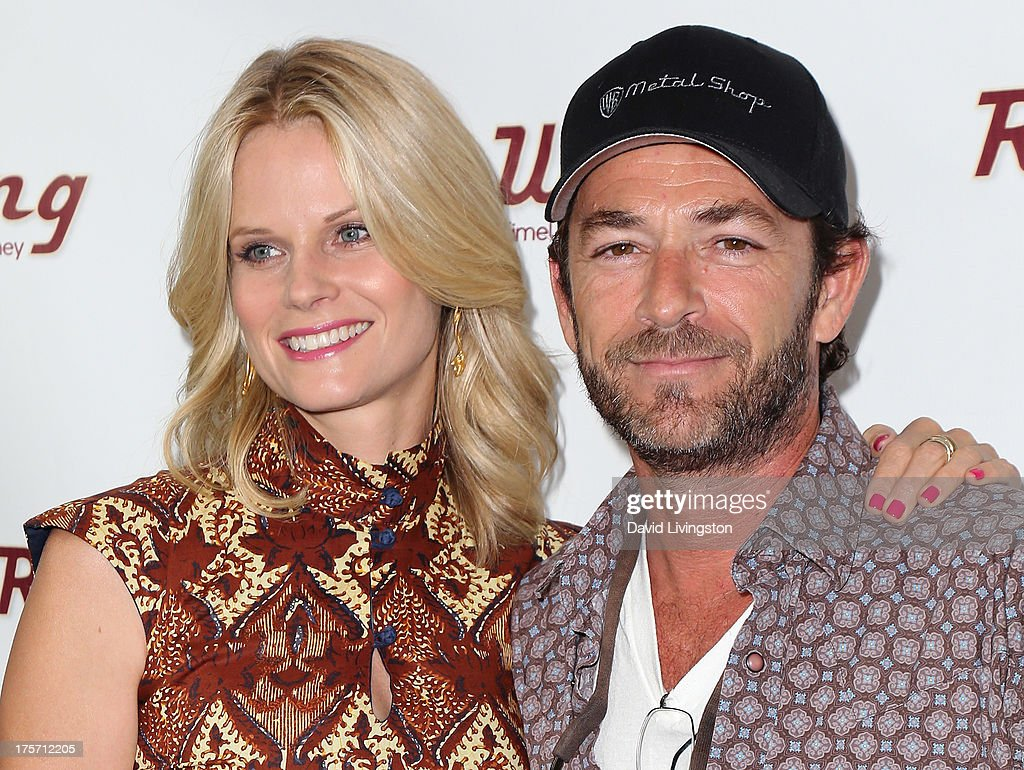 Actors Joelle Carter (L) and Luke Perry attend a screening of Integrity Film Production's 'Red Wing' at Harmony Gold Theatre on August 6, 2013 in Los Angeles, California.