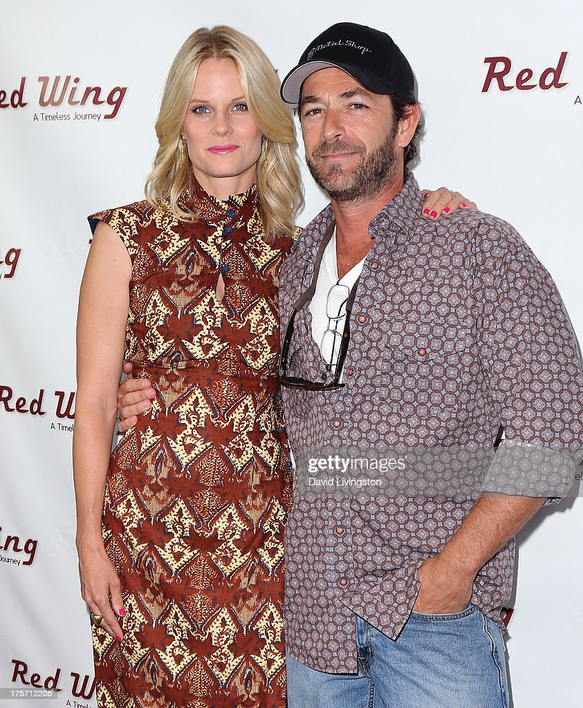 Actors <a gi-track='captionPersonalityLinkClicked' href=/galleries/search?phrase=Joelle+Carter&family=editorial&specificpeople=2433556 ng-click='$event.stopPropagation()'>Joelle Carter</a> (L) and <a gi-track='captionPersonalityLinkClicked' href=/galleries/search?phrase=Luke+Perry&family=editorial&specificpeople=171633 ng-click='$event.stopPropagation()'>Luke Perry</a> attend a screening of Integrity Film Production's 'Red Wing' at Harmony Gold Theatre on August 6, 2013 in Los Angeles, California.