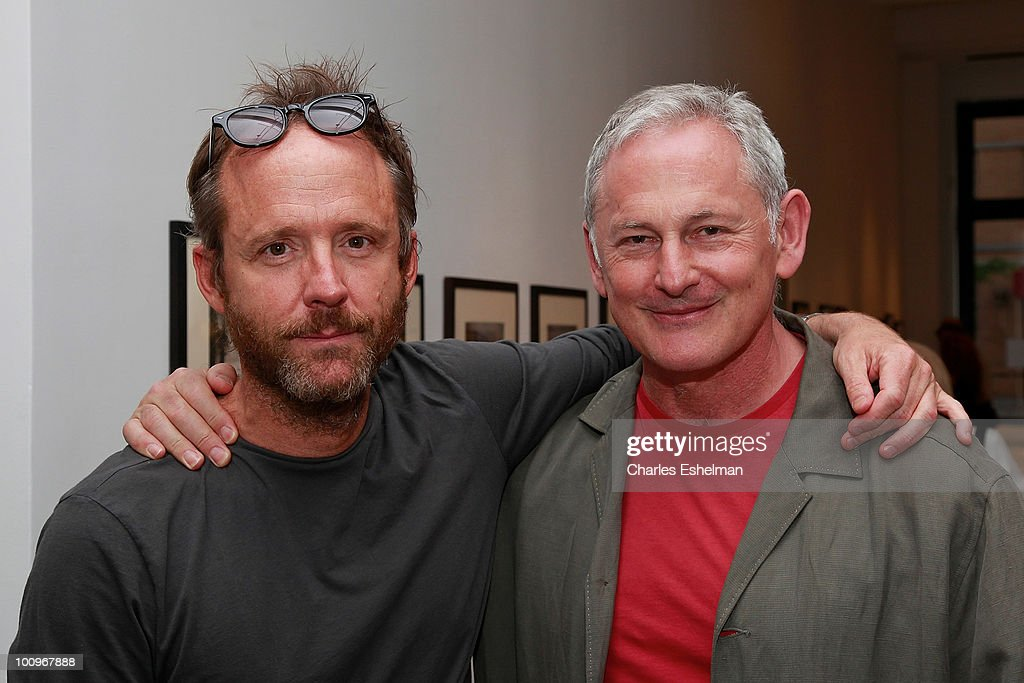 Actors John Benjamin Hickey and Victor Garber attend the photography exhibition opening for '1.3: New Color Images by Joel Grey' at Steven Kasher Gallery on May 25, 2010 in New York City.