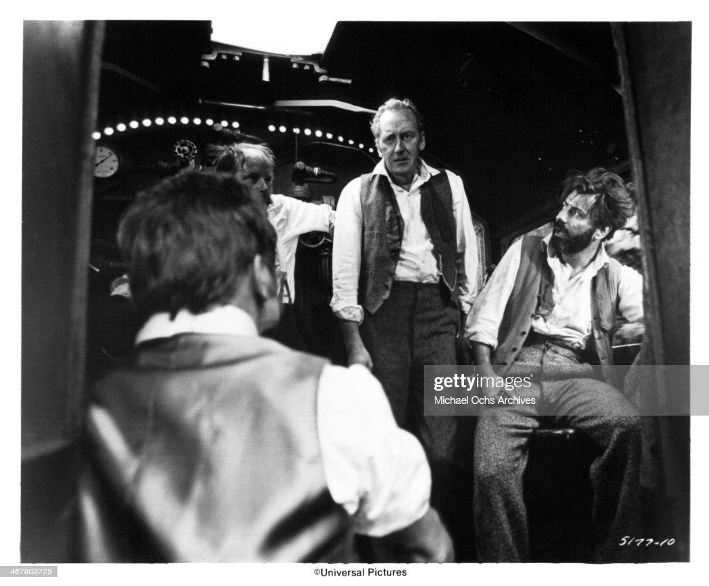 Actors John Bird Nicol Williamson and Alan Arkin on set of the Universal Pictures movie 'The SevenPerCent Solution' circa 1976