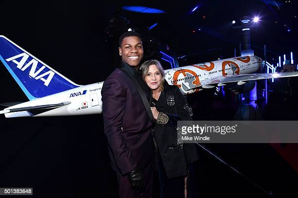 "Actors John Boyega and Carrie Fisher attend the World Premiere of ""Star Wars The Force Awakens"" at the Dolby El Capitan and TCL Theatres on December..."