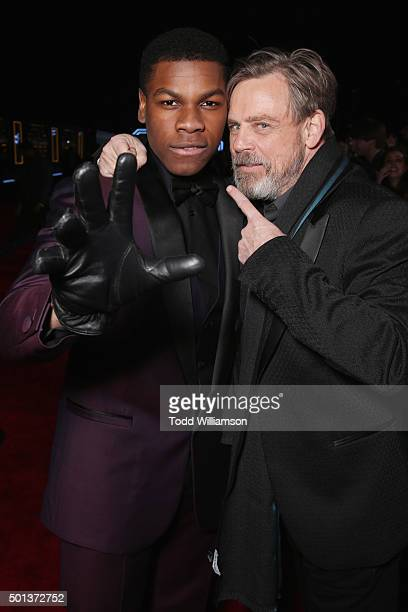 Actors John Boyega and Mark Hamill attend the Premiere of Walt Disney Pictures and Lucasfilm's 'Star Wars The Force Awakens' on December 14 2015 in...