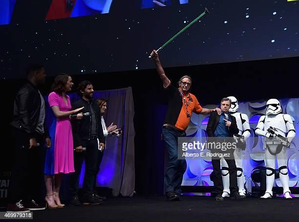 Actors John Boyega Daisy Ridley and Oscar Isaac producer Kathleen Kennedy actors Peter Mayhew and Mark Hamill onstage during Star Wars Celebration...