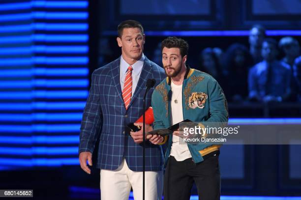 Actors John Cena and Aaron TaylorJohnson speak onstage during the 2017 MTV Movie And TV Awards at The Shrine Auditorium on May 7 2017 in Los Angeles...