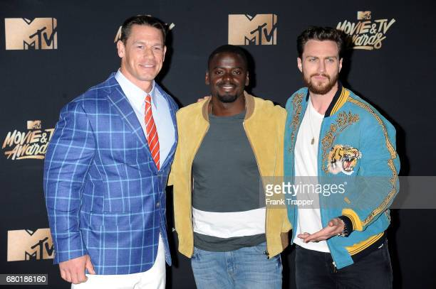 Actors John Cena Daniel Kaluuya winner of the Next Generation award and Aaron TaylorJohnson pose in the press room during the 2017 MTV Movie And TV...