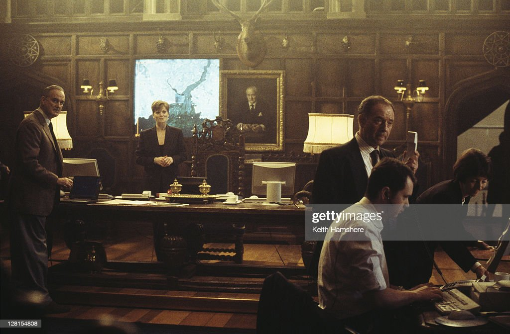 Actors John Cleese Samantha Bond and Michael Kitchen in the Scottish headquarters of MI6 in a scene from the James Bond film 'The World Is Not...