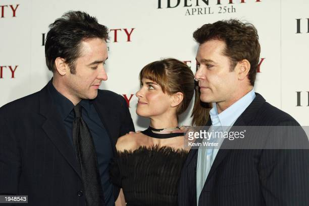 Actors John Cusack Amanda Peet and Ray Liotta pose at the premiere of 'Identity' at the Chinese Theater on April 23 2003 in Los Angeles California