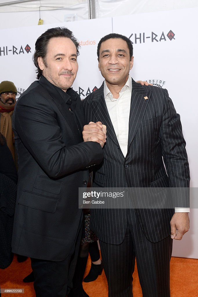 Actors John Cusack (L) and Harry Lennix attend the 'CHI-RAQ' New York Premiere at Ziegfeld Theater on December 1, 2015 in New York City.